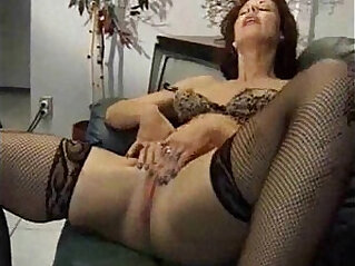 Two mature masturbating on a couch